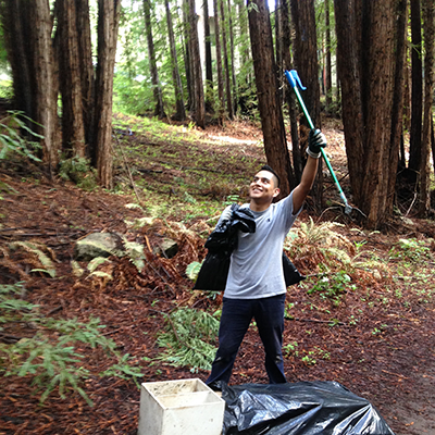 A UCSC Campus Natural Reserve stewardship intern cleans up the campus.