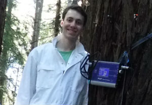 Sam Castro in the UCSC Forest Ecology Research Plot